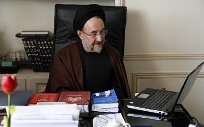 In this undated photo, former Iranian president Mohammad Khatami watches a video on his laptop in his office in Tehran, Iran. (AP Photo/Office of Mohammad Khatami, Asghar Khaksar)