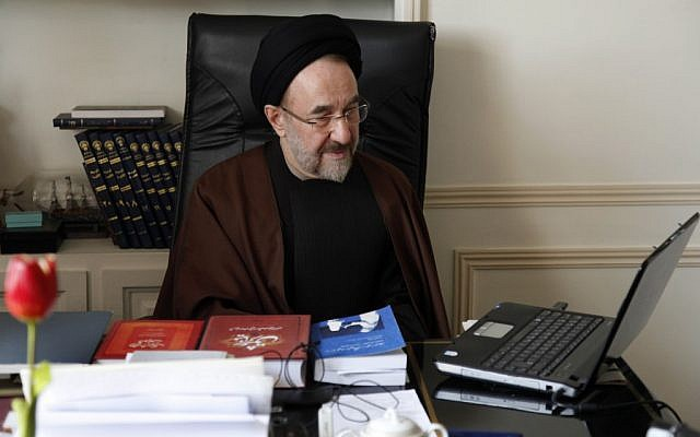 In this undated photo, former Iranian president Mohammad Khatami watches a video on his laptop in his office in Tehran, Iran. Many reformists are expected to sit out the June 14 voting in a silent protest over the crackdowns that have left them leaderless and demoralized. Others unwilling to boycott the election are rallying around a last-ditch call for help to Khatami, who is seen increasingly as their only credible hope at the ballot box. (AP Photo/Office of Mohammad Khatami, Asghar Khaksar)