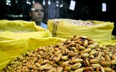 An Iranian man looks at pistachios for sale at a nut shop in western Tehran, Iran, last year. (AP Photo/Ebrahim Noroozi)