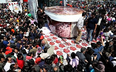 5-ton tub of ice-cream made by Iranian Choopan dairy is displayed during a ceremony at the Tochal mountainous area of northern Tehran, Iran, Monday, April 1 (photo credit: AP/Ebrahim Noroozi)