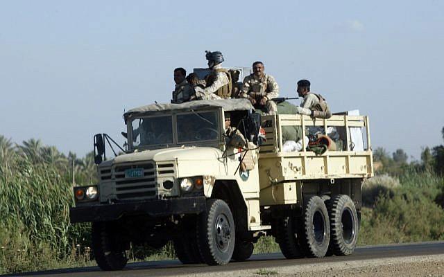 Iraqi army soldiers leaving Hawija, 150 miles (240 kilometers) north of Baghdad, Iraq, on April 23, 2013. (photo credit: AP/Hadi Mizban)