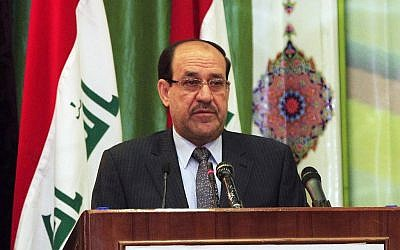Former Iraqi Prime Minister Nouri al-Maliki speaks during Convergence of religions conference in Baghdad, Iraq, Saturday, April 27, 2013 (photo credit: AP/Karim Kadim)
