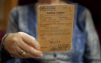 Aliza Vitis-Shomron holds a certificate from 1943. (Photo credit: AP/Ariel Shalit)