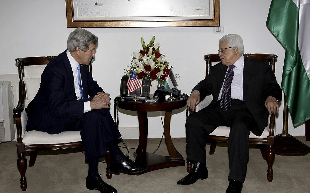 Palestinian President Mahmoud Abbas, right, meets with US Secretary of State John Kerry in Ramallah on Sunday, April 7, 2013. (photo credit:AP/Mohamed Torokman)