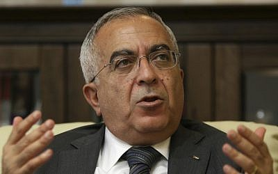 Palestinian Authority Prime Minister Salaam Fayyad speaks during an interview with The Associated Press in the West Bank city of Ramallah, 2011 (photo credit: AP/Majdi Mohammed, File)