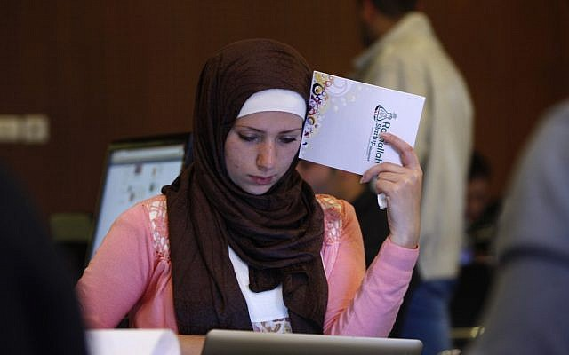 A Palestinian programmer attends a Ramallah Startup Weekend workshop on April 6. (photo credit: AP/Majdi Mohammed)