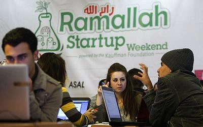 Palestinian programmers attend a Ramallah Startup Weekend workshop on April 5 (photo credit:AP/Majdi Mohammed)