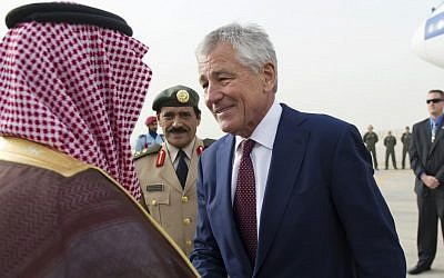 US Secretary of Defense Chuck Hagel is greeted by Saudi Arabia's Deputy Minister of Defense Prince Fahd bin Abdullah, left, upon his arrival at King Khaled International Airport in Riyadh, on April 23, 2013. (photo credit: AP Photo/Jim Watson, Pool)