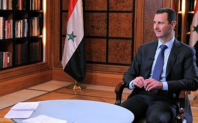 Bashar Assad, right, during an interview broadcast on Syrian state television in Damascus, Syria last month. (photo credit: AP/SANA)