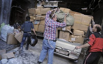Merchants remove their wares from the souk in the Old City of Aleppo, Syria. (photo credit: AP/Monica Prieto)