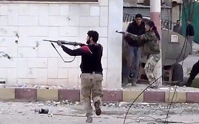 Free Syrian Army fighters fire at Syrian army soldiers during a fierce firefight in Syria, March 18, 2013. (photo credit: AP/Shaam News Network)