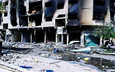 The aftermath of rocket attacks in Damascus, Syria, earlier this month (photo credit: AP/Local Council of Barzeh)