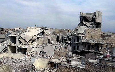 Destroyed homes in a government airstrike and shelling, in the neighborhood of Marjeh in the northern city of Aleppo, Syria, Thursday, April 11, 2013. (photo credit: AP/Aleppo Media Center)