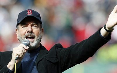 This April 20, 2013 file photo shows Neil Diamond singing 'Sweet Caroline' in the eighth inning of a baseball game between the Boston Red Sox and the Kansas City Royals in Boston. (photo credit: AP Photo/Michael Dwyer, file)