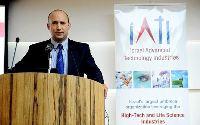Economics Minister Naftali Bennett speaks at the Multinational R&D forum sponsored by IATI on April 11 (Photo credit: Courtesy)