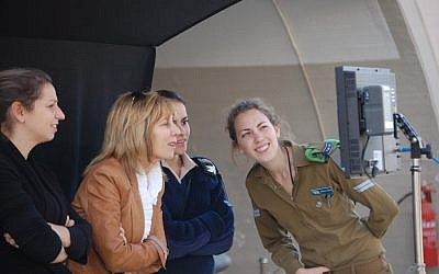 Producer Nancy Spielberg, second from left, monitoring filming action at the Hatzerim Air Force base in southern Israel. (photo credit: Courtesy  Nancy Spielberg/JTA)