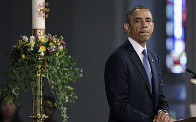 """President Barack Obama pauses while speaking at the """"Healing Our City: An Interfaith Service"""" at the Cathedral of the Holy Cross in Boston, Thursday, April 18, 2013 (AP Photo/Susan Walsh)"""