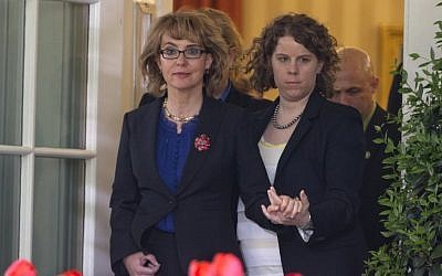 Former congresswoman Gabrielle Giffords is helped as she arrives for a news conference in the Rose Garden of the White House, Wednesday, April 17. (photo credit: AP/Carolyn Kaster)