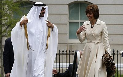 Abu Dhabi Crown Prince Sheik Mohammed bin Zayed al Nahyan walks with US Chief of Protocol Capricia Marshall as they arrive at the West Wing of the White House in Washington, Tuesday, April 16, 2013, for a private lunch with US President Barack Obama. (photo credit: AP/Charles Dharapak)