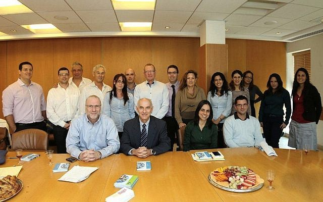 Members of the joint Finance Ministry-SwiftNess steering committee celebrating the completion of the SwiftNess website. Seated (left to right): Effi Kotek, President Ness Israel; Professor Oded Sarig; Lee Dagan; Victor Weiss, Finance Ministry (photo credit: Courtesy Ness Technologies)