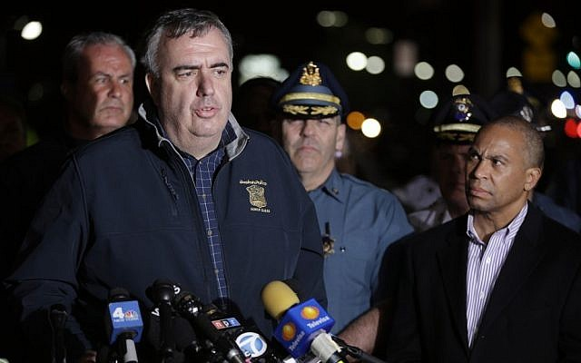 Boston police commissioner Ed Davis talks to reporters, Friday. (photo credit: AP/Matt Rourke)