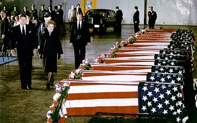 American ex-president Ronald Reagan and his wife, Nancy, view the caskets of American diplomats killed in the 1983 bombing of the US Embassy in Beirut, Lebanon. (Courtesy Ronald Reagan Presidential Library)
