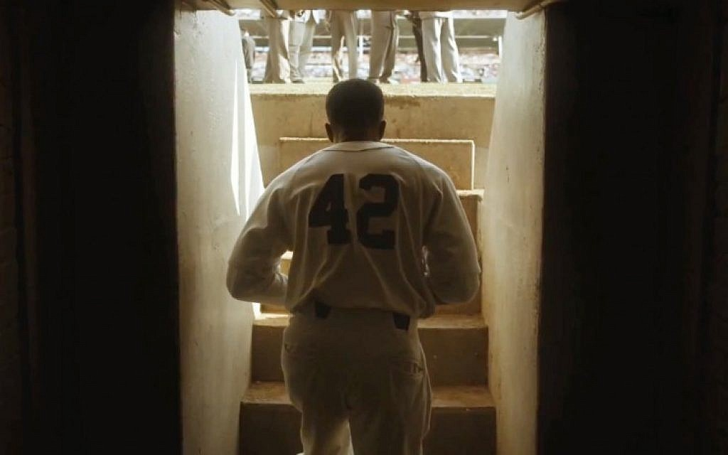 Chadwick Boseman playing Jackie Robinson getting ready to take the field in the new film '42.' (photo credit: Legendary Pictures/JTA)