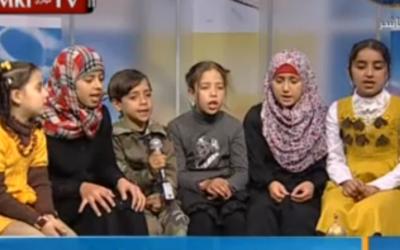 The grandchildren of late Hamas MP Umm Nidal sing the virtues of jihad and martyrdom on Hamas's Al-Aqsa TV. (Image capture from MEMRI TV video)