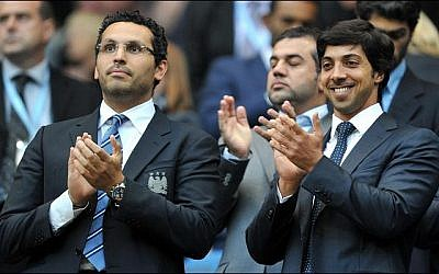Sheikh Mansour bin Zayed Al Nahyan, right, attends a soccer match in England (photo credit: public domain)