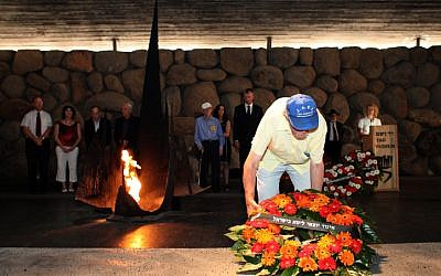 A Holocaust survivor lays a wreath in the Hall of Remembrance at the Yad Vashem Holocaust memorial in Jerusalem. September 20, 2012. (photo credit: Yoav Ari Dudkevitch/Flash90)