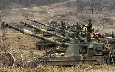 South Korean marines stand on their K-55 self-propelled howitzers during an exercise against possible attacks by North Korea near the border village of Panmunjom in Paju, South Korea on Monday, April 1, 2013 (photo credit: AP/Ahn Young-joon)
