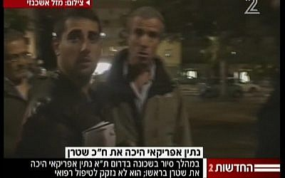 Hatnua MK Elazar Stern, right, after being attacked during a tour of Tel Aviv's southern neighborhoods Sunday, April 21. (photo credit: image capture/Channel 2)