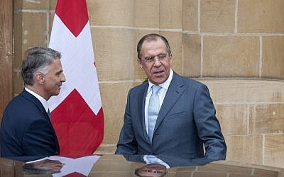 Russian Foreign Minister Sergey Lavrov, right, is welcomed by Switzerland's Federal Councillor and Foreign Minister Didier Burkhalter for a working visit in Neuchatel, Switzerland on Friday (photo credit: AP/Keystone/Sandro Campardo)
