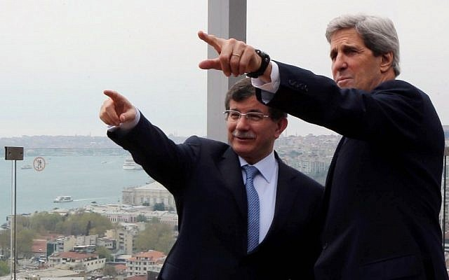 US Secretary of State John Kerry, right, and his Turkish counterpart, Ahmet Davutoglu, point toward the Bosporus in Istanbul, Turkey, Sunday, April 21, 2013. (photo credit: AP/Hakan Goktepe, Pool)