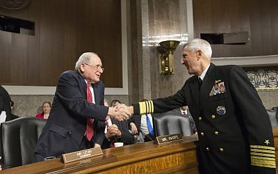 Senate Armed Services Committee Chairman Sen. Carl Levin, D-Mich., left, welcomes Adm. Samuel Locklear, commander of U.S. Pacific Command, on Capitol Hill in Washington, Tuesday, April 9, 2014, prior to Locklear testifying before the committee's hearing focusing on the Korean peninsula (AP Photo/J. Scott Applewhite)
