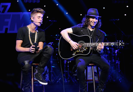 Pop star Justin Bieber and his lead guitarist and musical director, Dan Kantner (right), in concert (photo credit: Courtesy)