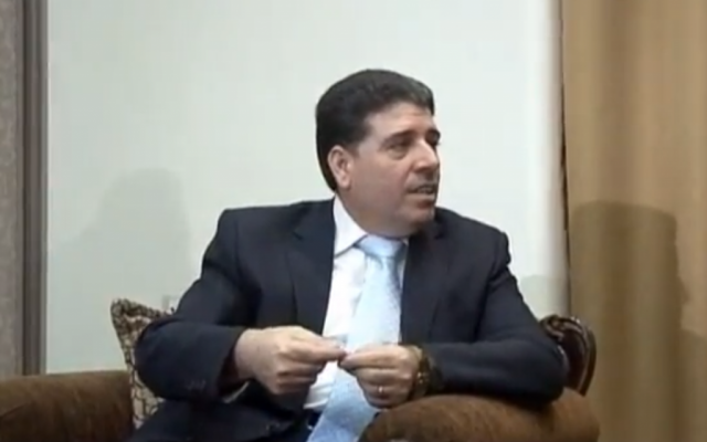 Syrian Prime Minister Wael al-Halqi in 2012. (photo credit: image capture from YouTube video uploaded by euronewses)