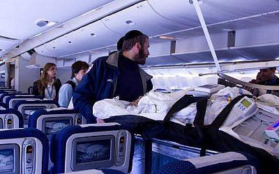 Sima Avishar is wheeled onto the plane en route to Israel (photo credit: vitalone.org)