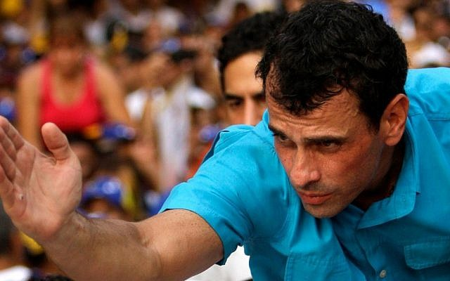 Opposition presidential candidate Henrique Capriles, the Catholic grandson of Holocaust survivors, greets supporters as he campaigns in Maracay, Venezuela, on Thursday. (photo credit: AP Photo/Fernando Llano)