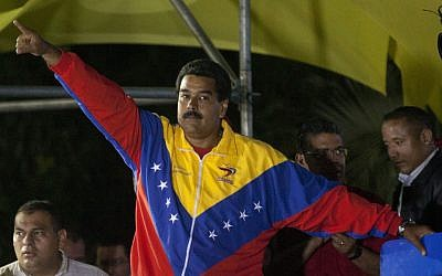 Venezuela's newly elected President Nicolas Maduro celebrates his victory at the Miraflores Palace in Caracas, Venezuela, Sunday, April 14, 2013. (photo credit: AP/Ramon Espinosa)