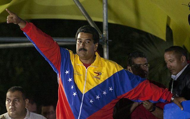 Venezuela's newly elected President Nicolas Maduro celebrates his victory at the Miraflores Palace in Caracas, Venezuela, Sunday, April 14, 2013. (photo credit: AP/Ramon Espinosa)