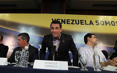 Venezuelan presidential candidate Henrique Capriles, center, at a news conference in Caracas, Venezuela, on Monday, April 1, 2013. (photo credit: Fernando Llano/AP)