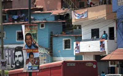 Posters featuring Venezuela's late president Hugo Chavez and interim President Nicolas Maduro hang on a pole at the 23 de Enero neighborhood in Caracas, Venezuela, Friday, April 12, 2013. Maduro,who served as Chavez's foreign minister and vice president, is running against part-Jewish opposition candidate Henrique Capriles in Sunday's presidential election. (AP Photo/Ariana Cubillos)