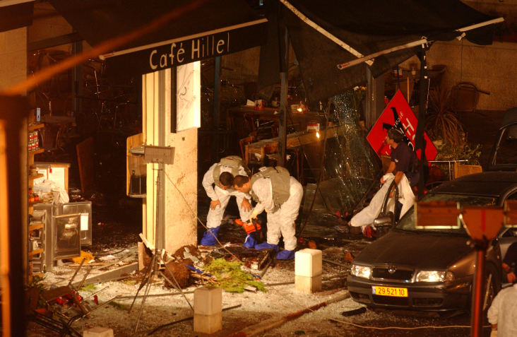A general view of the scene of a suicide bombing on September 9, 2003 after a Palestinian suicide bomber blew himself up at the entrance of Cafe Hillel coffee shop in Jerusalem. (photo credit: Flash 90)
