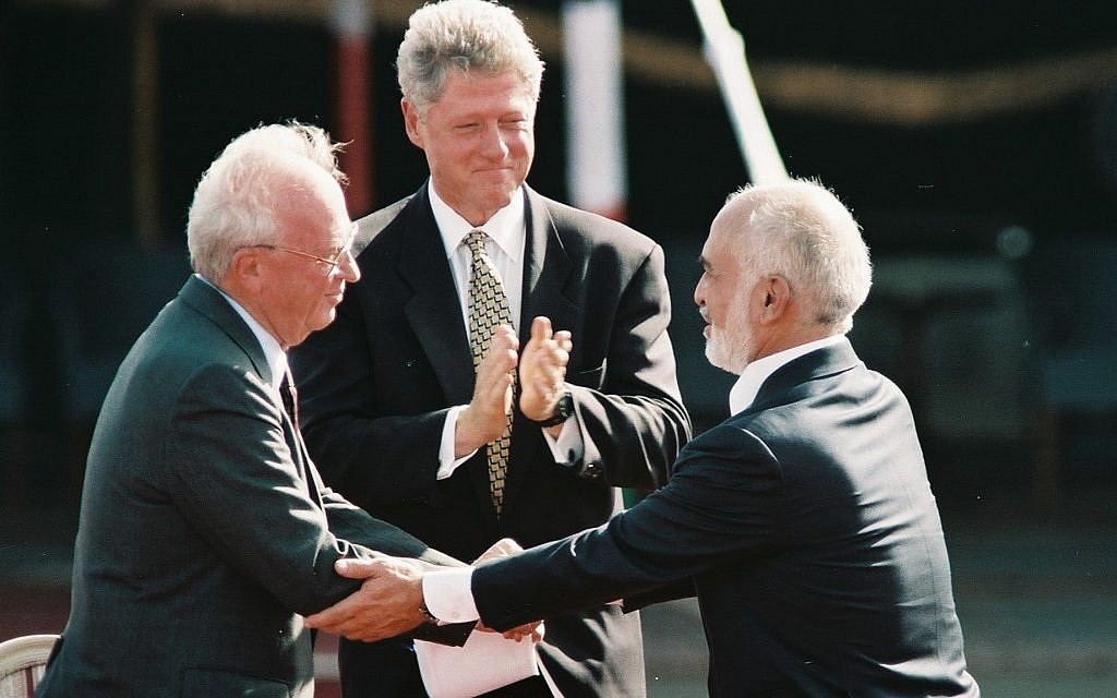 Israeli prime minister Yitzhak Rabin (left) shakes the hand of Jordan's King Hussein at the signing of the bilateral peace treaty, October 1994 (photo credit: Nati Shohat/Flash90)