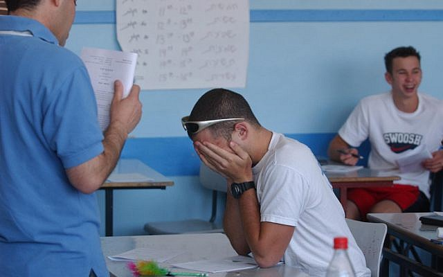 Students taking their matriculation exams in a classroom on March 06, 2004 (photo credit: Flash90)