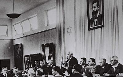 David Ben-Gurion, flanked by the members of his provisional government, reads the Declaration of Independence in the Tel Aviv Museum Hall on May 14, 1948 (Israel Government Press Office)