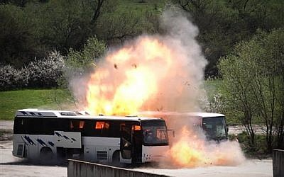 Bulgarian investigators stage a reenactment of the bus bombing in July 2012 that killed five Israeli tourists at the Burgas airport, on Friday, April 26, 2013. (photo credit: AP/Valentina Petrova)