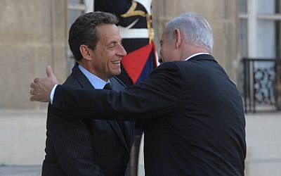 Prime Minister Benjamin Netanyahu embraces then French president Nicholas Sarkozy in Paris, in 2011 (photo credit:  Amos Ben Gershom/GPO)