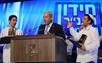 Illustrative: Benjamin Netanyahu (center) with the Bible Quiz winners. (Marc Israel/Flash90)